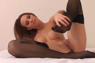 A splendid babe with very nice feet wears black stockings