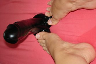 She gives footjob to a monster dildo