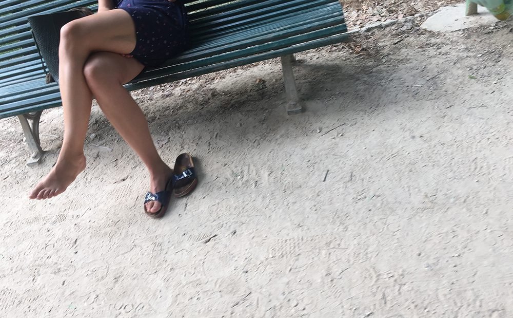 Female feet with sandal clappers