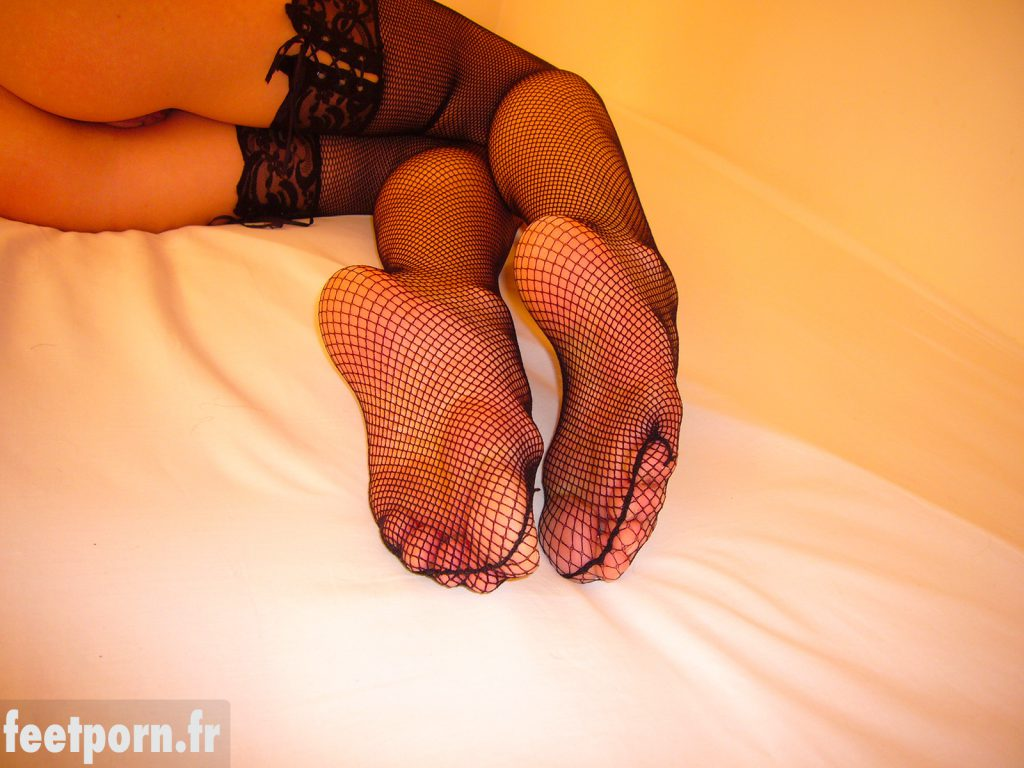 An amateur girl with sexy fishnet stockings