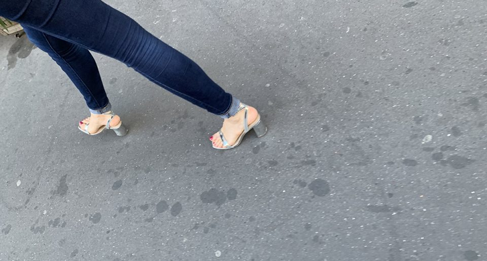 She walks with sexy silver sandals