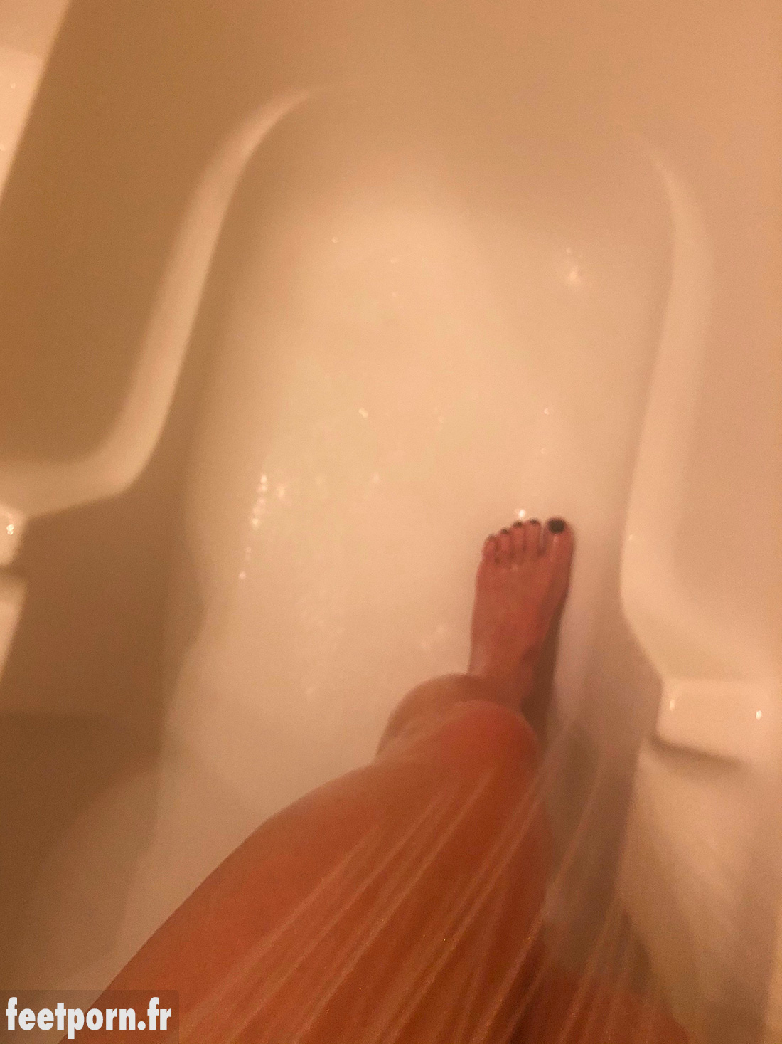 Naked in the shower she shows her feet