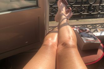 A hot mature slut sunbathing