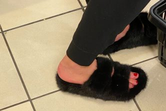Vulgar girl with fur tap sandals